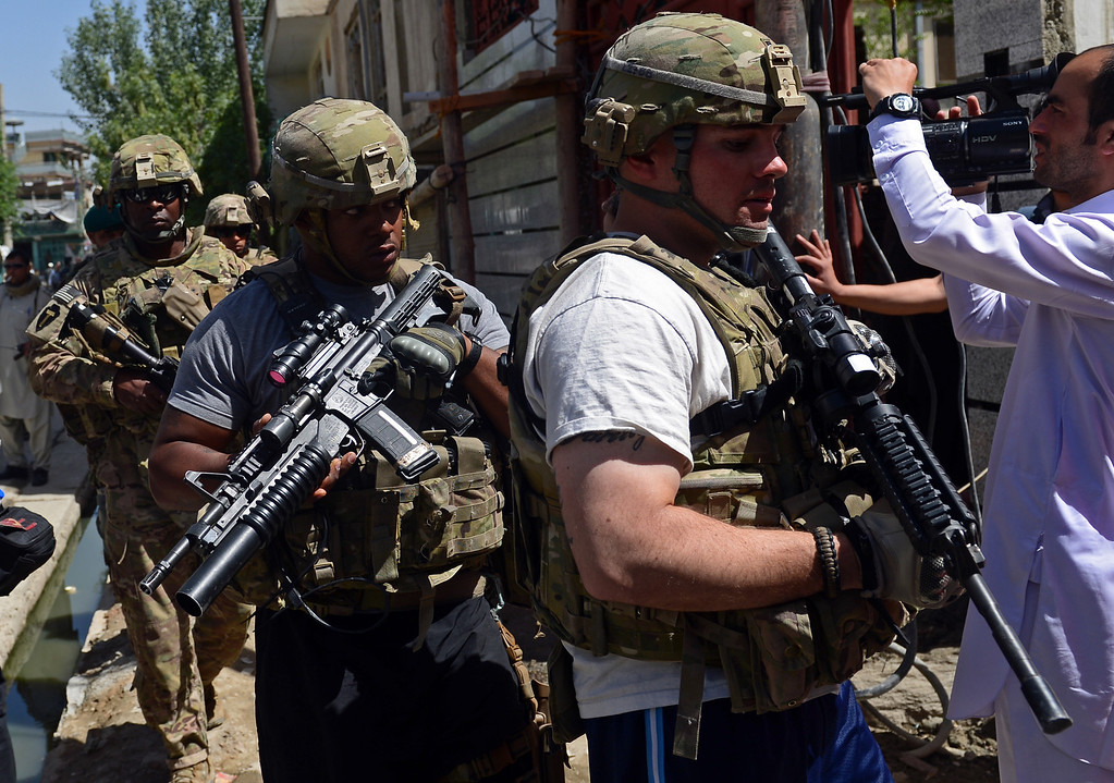 . US soldiers arrive to the site of a suicide attack in Kabul on May 16, 2013. AFP PHOTO/ Massoud HOSSAINI/AFP/Getty Images