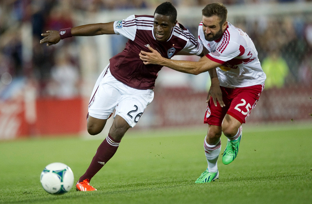 . DENVER - JULY 4: Deshorn Brown, #26 of the Colorado Rapids, fights for possession of the ball against Brandon Barklage, #25 of the New York Red Bulls during the second half of a MLS soccer match against the New York Red Bulls on July 4, 2013 at Dick\'s Sporting Goods Park. The Rapids defeated the Red Bulls 2-0. (Photo By Grant Hindsley / The Denver Post)