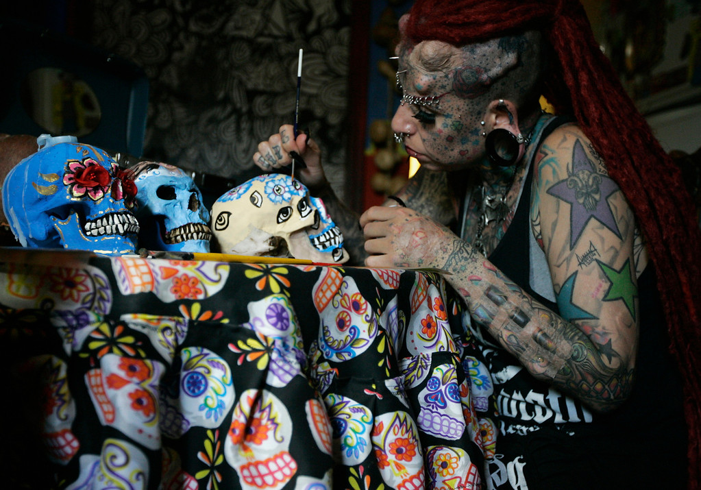 . Maria Jose Cristerna paints decorative skulls to be sold as art pieces at her home in Guadalajara February 29, 2012.  REUTERS/Alejandro Acosta