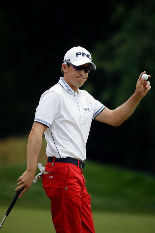 . Scott Langley reacts after putting on the first hole during the third round of the U.S. Open golf tournament at Merion Golf Club, Saturday, June 15, 2013, in Ardmore, Pa. (AP Photo/Morry Gash)