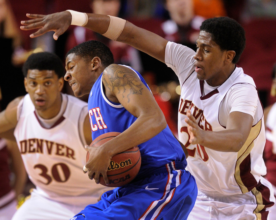. Pioneers forward Royce O\'Neale (20) played tight defense on Bulldogs guard Alex Hamilton (0) in the first half. The University of Denver men\'s basketball team hosted the Louisiana Tech Bulldogs at Magness Arena Saturday night, March 9, 2013. (Photo By Karl Gehring/The Denver Post)
