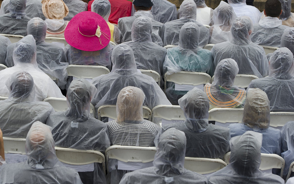 ". Guests wear ponchos in the rain during the Let Freedom Ring Commemoration and Call to Action to commemorate the 50th anniversary of the March on Washington for Jobs and Freedom at the Lincoln Memorial in Washington, DC on August 28, 2013. Thousands will gather on the mall on the anniversary of the march and Dr. Martin Luther King, Jr.\'s famous ""I Have a Dream\"" speech.   SAUL LOEB/AFP/Getty Images"