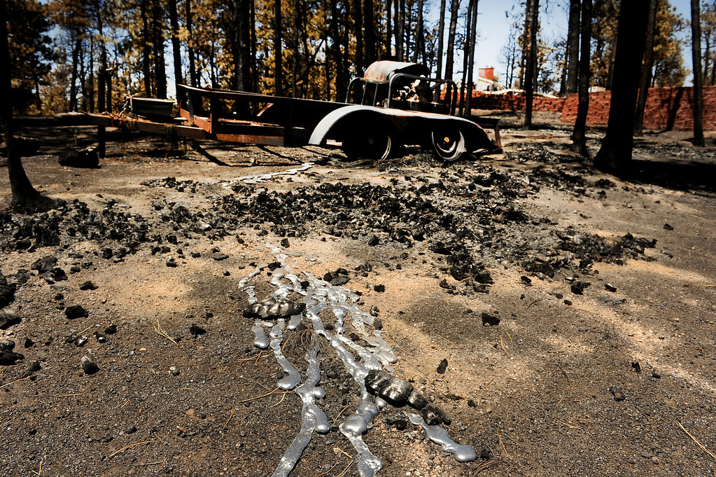 . BLACK FOREST, CO - JUNE 19:  A trailer on the property of Cindy and Ray Mitchell is a complete loss on Darr Drive in Black Forest, CO on June 19, 2013.   Cindy and Ray Mitchell came home for the first time since the fire in Black Forest, CO on June 19, 2013.  Her husband Ray had seen the fire coming almost immediately as it had started just southwest of their home. Their\'s was one of the first houses to burn.  The couple had lived in the home for over 22 years and were even married on the property.  The Black Forest Fire stands at 85% containment and more and more homeowners are being allowed back into their homes for a few hours each day. 14, 280 acres have burned and the total number of homes lost increased to 509.  Photo by Helen H. Richardson/The Denver Post)