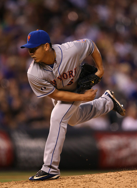 . DENVER, CO - MAY 03:  Relief pitcher Daisuke Matsuzaka #16 of the New York Mets delivers against the Colorado Rockies after replacing the starting pitcher Jenrry Mejia #58 of the New York Mets in the fifth inning at Coors Field on May 3, 2014 in Denver, Colorado.  (Photo by Doug Pensinger/Getty Images)