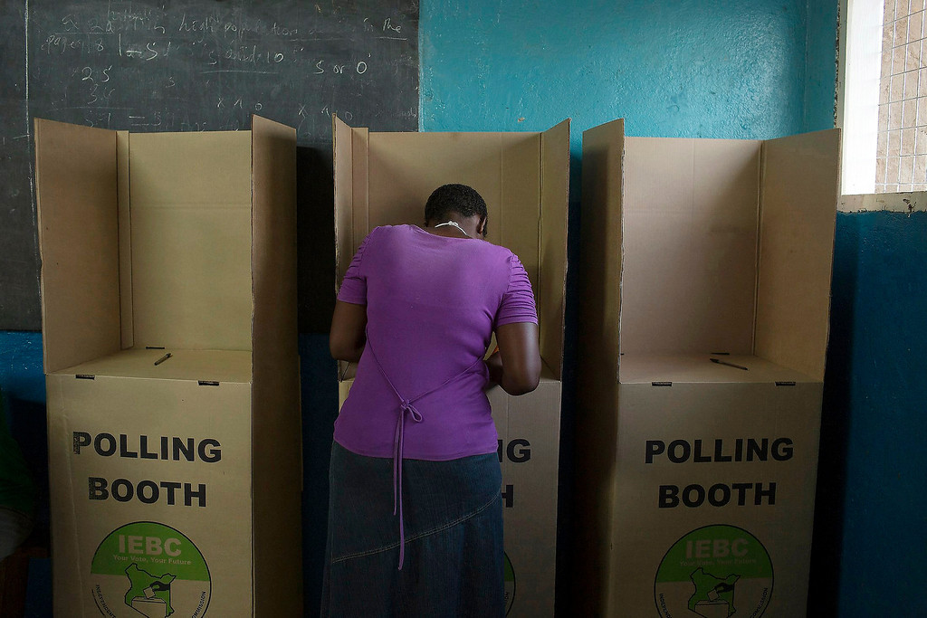 . A woman casts her vote during the Kenyan general elections at the Girgir primary school in Archers Post, Isiolo County in northern Kenya March 4, 2013. Polling stations opened up to Kenyans on Monday for a tense presidential election that will test whether the east African nation can repair its damaged reputation after the tribal blood-letting that followed a 2007 poll. REUTERS/Siegfried Modola