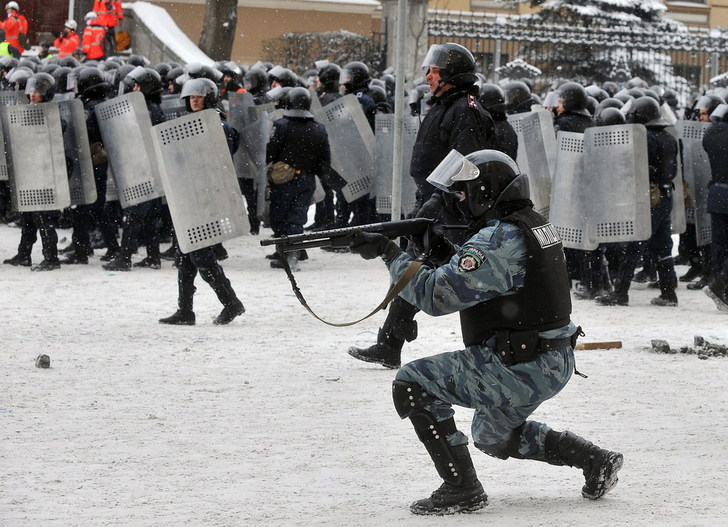 . A riot policeman takes aim at demonstrators during clashes between protestors and police in the center of Kiev on January 22, 2014. AFP PHOTO / GENYA  SAVILOV/AFP/Getty Images