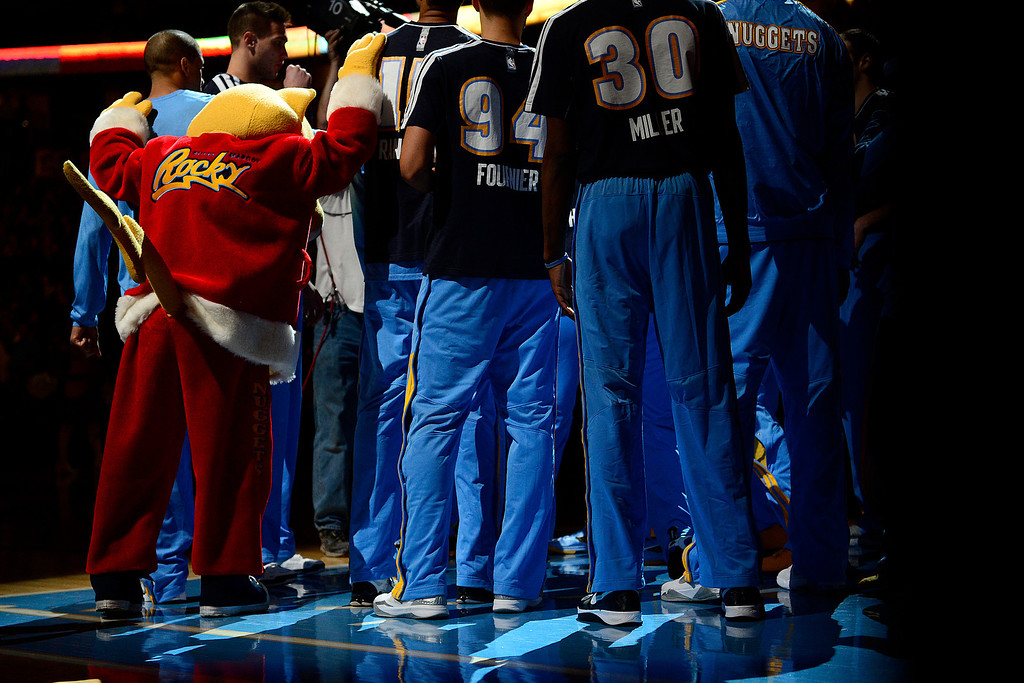 . Denver Nuggets mascot Rocky stands with the team during the first half at the Pepsi Center on Monday, December 3, 2012. AAron Ontiveroz, The Denver Post