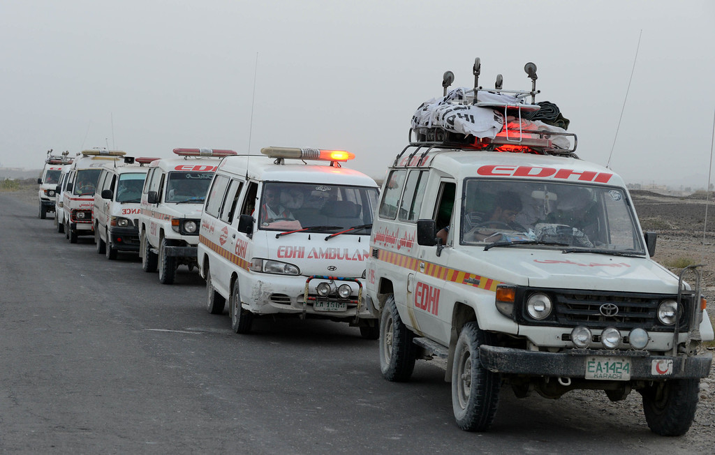 . Ambulances carry injured Pakistani earthquake survivors from one hospital that overwhelmed to another in the devastated district of Awaran on September 28, 2013. A powerful 6.8-magnitude earthquake hit southwest Pakistan, killing at least 22 people in a region already devastated by a tremor which left more than 300 people dead this week, local officials said. BANARAS KHAN/AFP/Getty Images