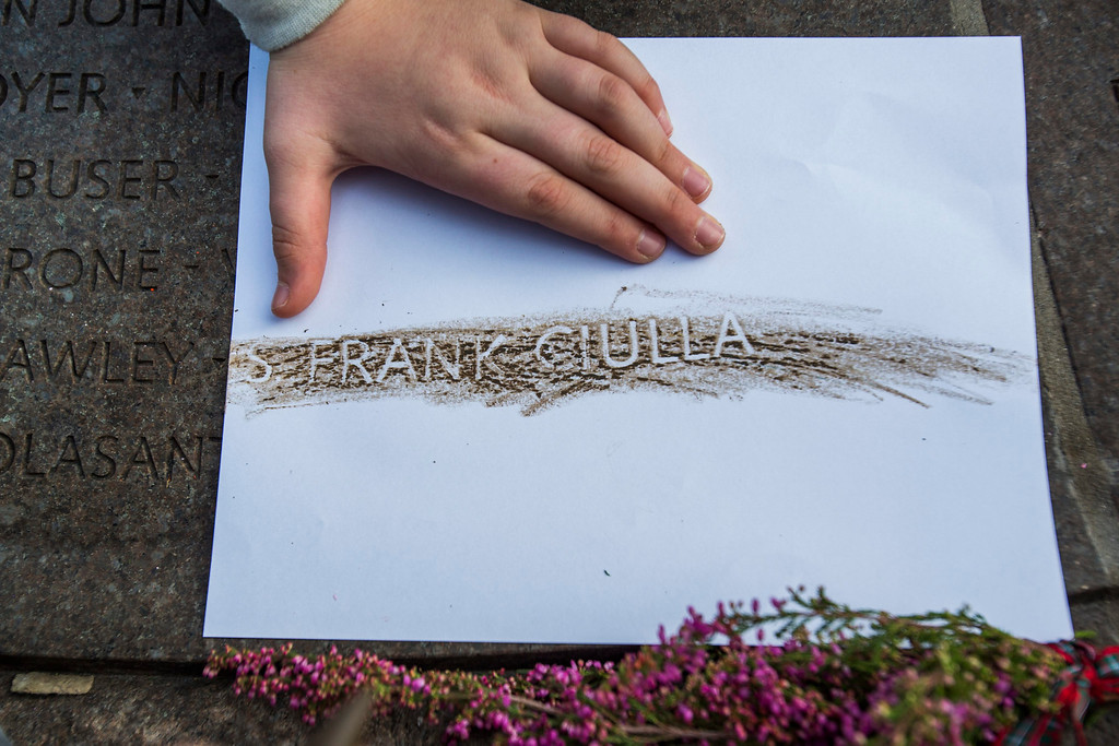 . Leo Ciulla makes an etching of his grandfather\'s name, Frank Ciulla, from a memorial cairn in Arlington National Cemetery which honors those killed on Pan Am flight 103 on the 25th anniversary of the incident in Arlington, Virginia, USA, 21 December 2013.   EPA/JIM LO SCALZO