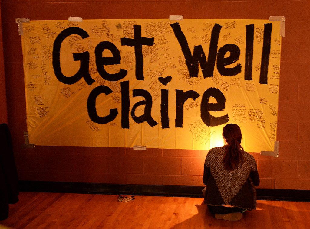 . CENTENNIAL, CO. - DECEMBER 20:  Scores of persons, including Angela Goncalves, signed a card for Claire Davis following a candlelight vigil Friday night. Reverend Bradley Stoltenow led the candlelight vigil for Claire Davis at Shepherd of the Hills Lutheran Church December 20, 2013. The church is located just a block from Arapahoe High School and was one of the locations that students were led following the shooting last week. Photo By Karl Gehring/The Denver Post