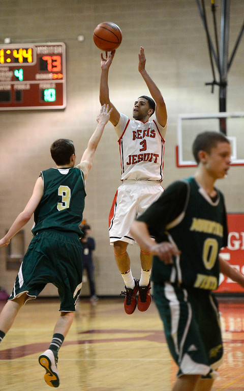 . LITTLETON, CO. - JANUARY 29: Regis Josh Perkins (3) goes up for a shot over Mountain Vista Jake Pemberton (3) with 1:44 left fourth quarter during their game January 29, 2013 at Regis.  (Photo By John Leyba / The Denver Post)