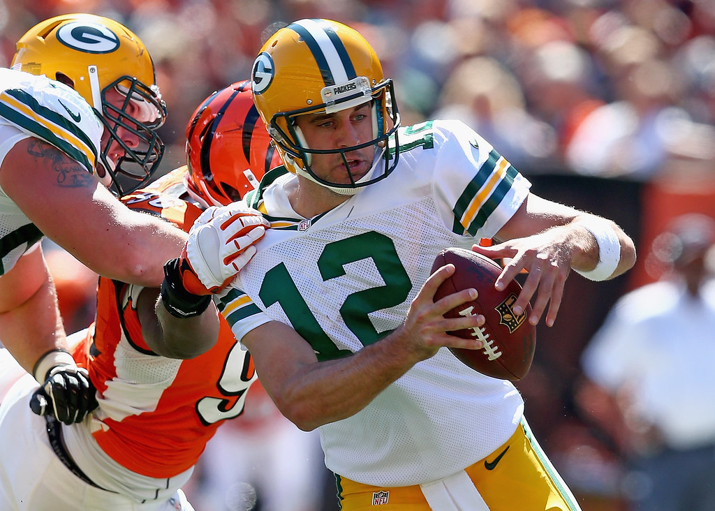 . Aaron Rodgers #12 of the Green Bay Packers runs with the ball during the NFL game against Cincinnati Bengals at Paul Brown Stadium on September 22, 2013 in Cincinnati, Ohio.  (Photo by Andy Lyons/Getty Images)