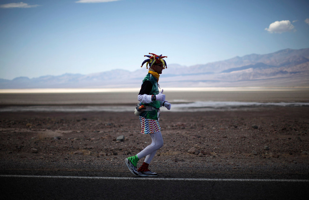 . Ed Ettinghausen, 50 competes in the Badwater Ultramarathon in Death Valley National Park, California July 15, 2013. The 135-mile (217 km) race, which bills itself as the world\'s toughest foot race, goes from Death Valley to Mt. Whitney, California in temperatures which can reach 130 degrees Fahrenheit (55 Celsius).  REUTERS/Lucy Nicholson