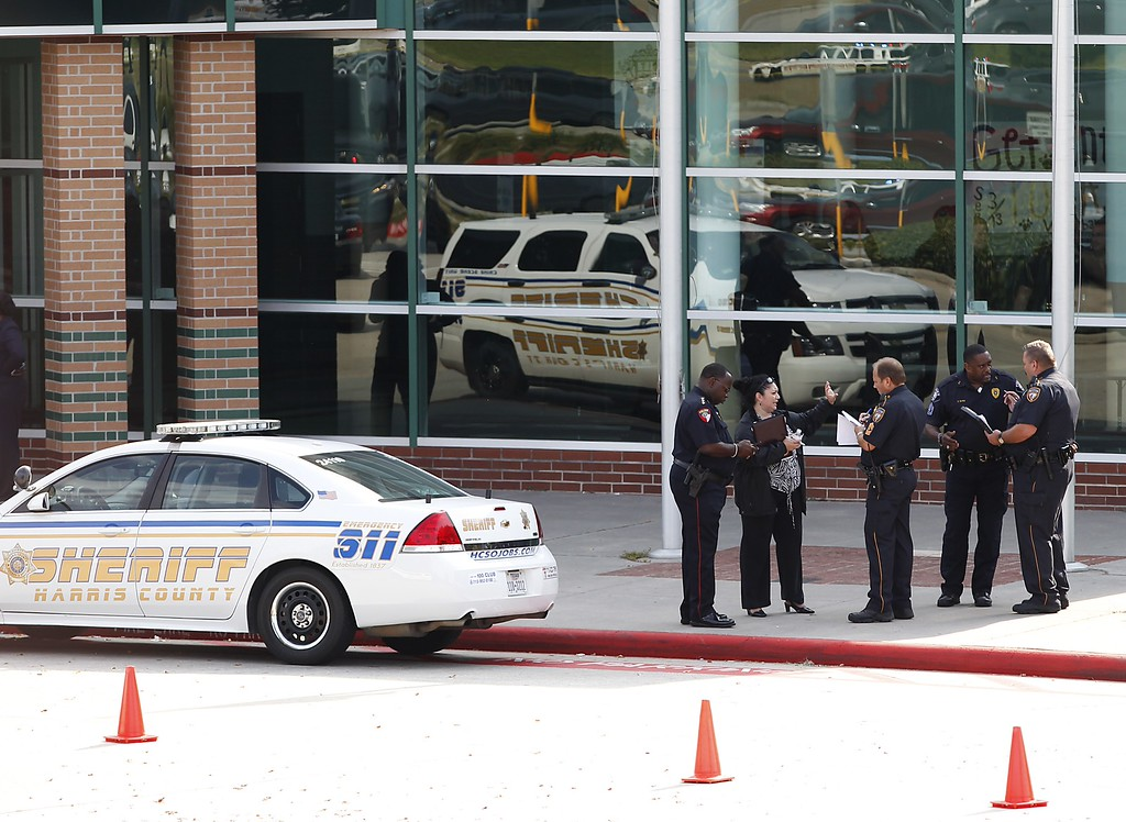 . Police stand in front of Spring High School after a stabbing September 4, 2013 in Spring, Texas.  (Photo by Thomas B. Shea/Getty Images)