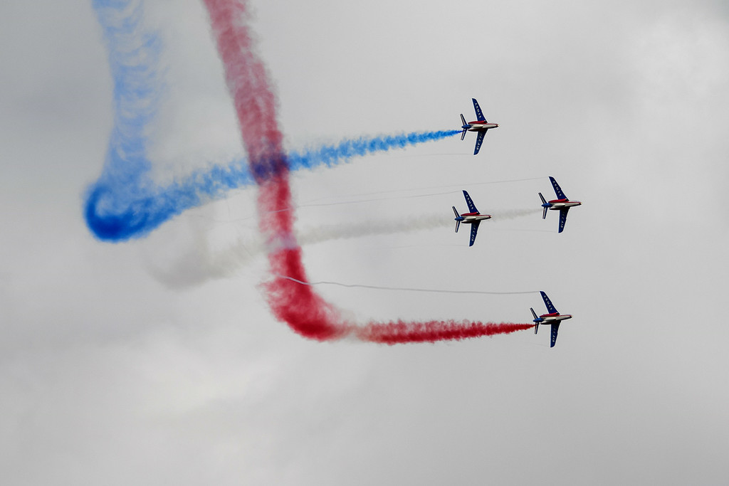 """. Jets of the \""""The Patrouille de France\"""" perform during the first day of AIR14 air show on August 30, 2014 in Payerne, western Switzerland. T  AFP PHOTO / FABRICE  COFFRINI/AFP/Getty Images"""