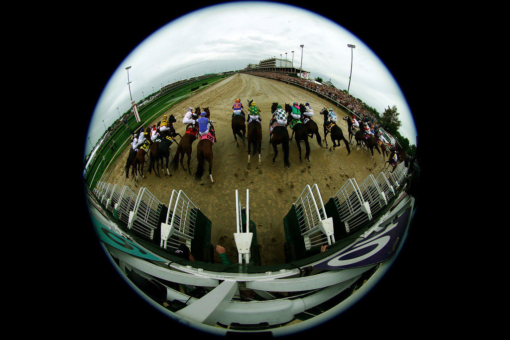 . LOUISVILLE, KY - MAY 04:  The field comes out of the gate to start the 139th running of the Kentucky Derby at Churchill Downs on May 4, 2013 in Louisville, Kentucky.  (Photo by Doug Pensinger/Getty Images)