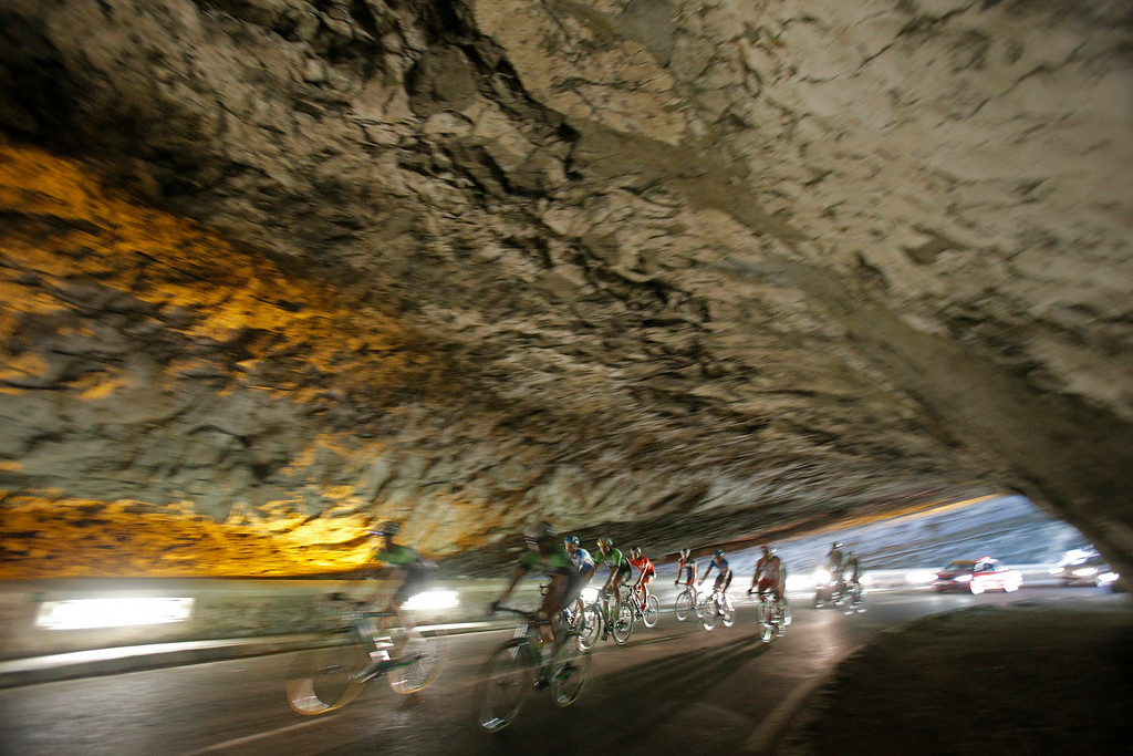 . The pack rides through a tunnel during the sixteenth stage of the Tour de France cycling race over 237.5 kilometers (147.6 miles) with start in Carcassonne and finish in Bagneres-de-Luchon, France, Tuesday, July 22, 2014. (AP Photo/Christophe Ena)