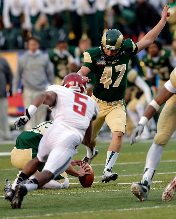 . Colorado State kicker Jared Roberts (47) kicks the game winning field goal as Washington State defender Rickey Galvin (5) defends during the second half of the NCAA New Mexico Bowl college football game, Saturday, Dec. 21, 2013, in Albuquerque, N.M. Colorado State won 48-45.(AP Photo/Matt York)