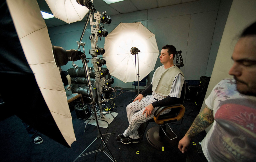. New York Yankees pitcher Boone Logan poses for 3-D photos for use in video games during media photo day at the team\'s MLB spring training complex at George M. Steinbrenner Field in Tampa, Florida, February 20, 2013. REUTERS/Steve Nesius