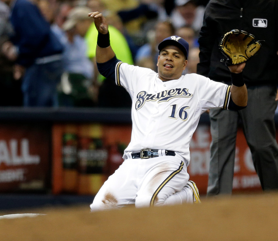 . Milwaukee Brewers\' Aramis Ramirez reacts after throwing out Atlanta Braves\' Andrelton Simmons in the seventh inning of an opening day baseball game Monday, March 31, 2014, in Milwaukee.  (AP Photo/Jeffrey Phelps)
