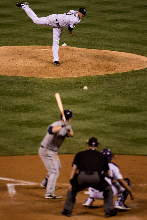 . Starting pitcher Jeff Manship #50 of the Colorado Rockies delivers to home plate during the fifth inning against the San Diego Padres at Coors Field on August 13, 2013 in Denver, Colorado.  (Photo by Justin Edmonds/Getty Images)
