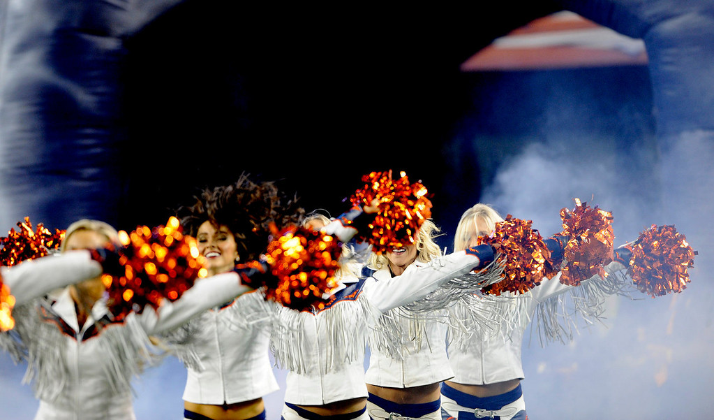 . Broncos\' cheerleaders take to the field at the start of the game. The Denver Broncos took on the Kansas City Chiefs at Sports Authority Field on Nov. 17, 2013. (Photo By Erin Hull/The Denver Post)