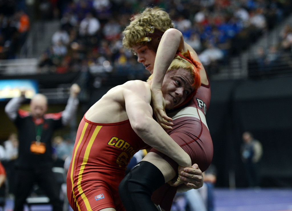 . DENVER, CO. - FEBRUARY 22: Jess Hankin of Coronado High School, left, lifts Kade Snider of Ponderosa during semifinal of 113 pound class of 5A State Championship tournament at Pepsi Center February 22, 2013. Denver, Colorado. Hankin won the match. (Photo By Hyoung Chang/The Denver Post)