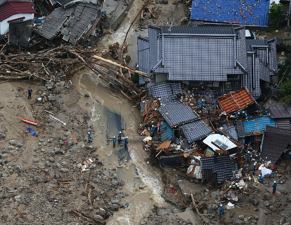 . This aerial view shows rescue workers looking for survivors at the site of a landslide after heavy rains hit the city of Hiroshima, western Japan, on August 20, 2014.    AFP PHOTO/Jiji PressJIJI PRESS/AFP/Getty Images