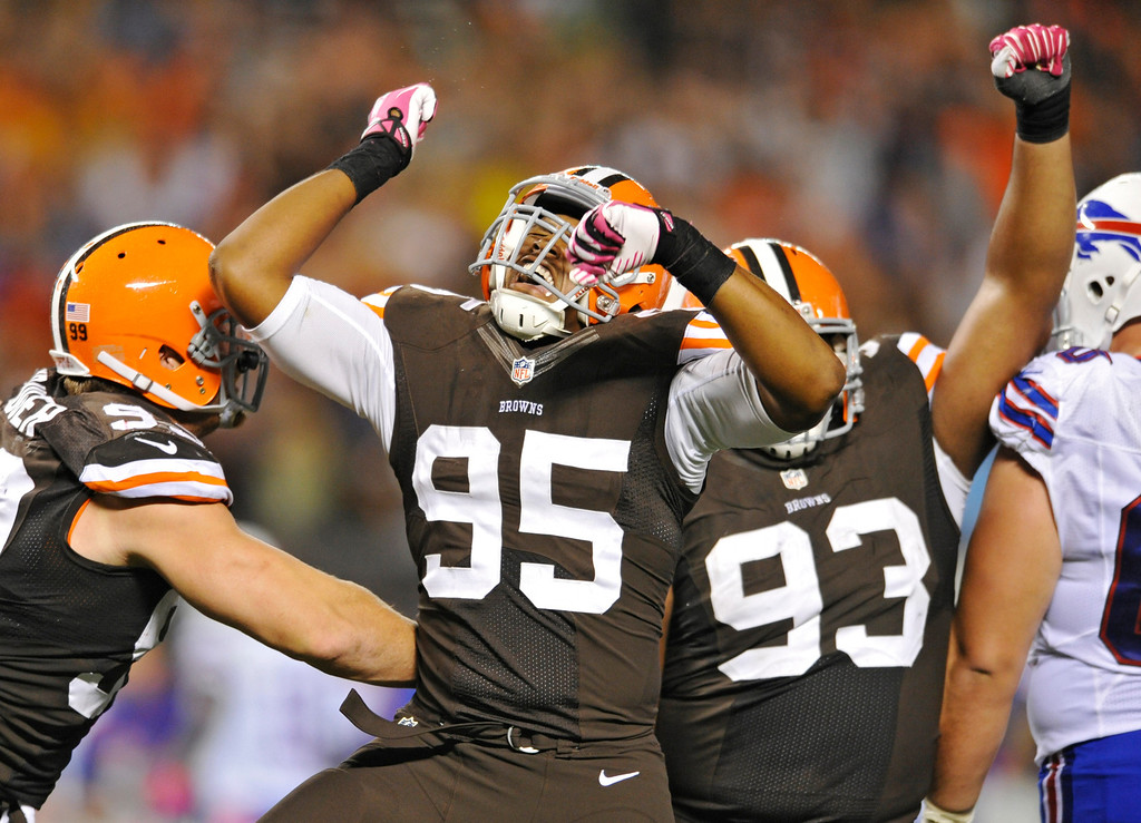 . Cleveland Browns defensive end Armonty Bryant (95) celebrates after sacking Buffalo Bills quarterback Jeff Tuel in the third quarter of an NFL football game Thursday, Oct. 3, 2013, in Cleveland. (AP Photo/David Richard)