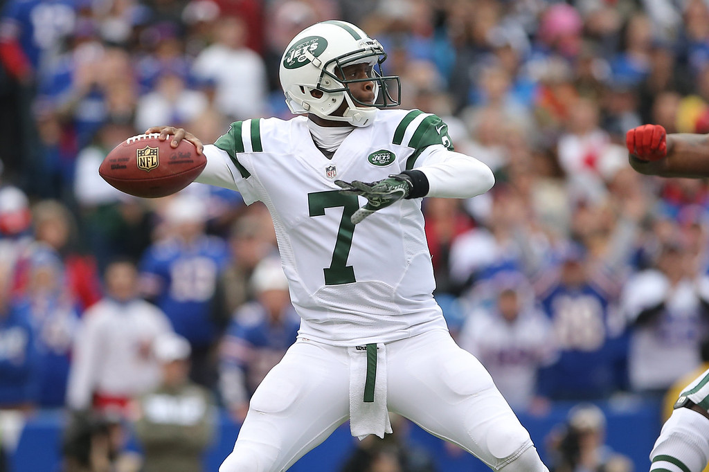 . Geno Smith #7 of the New York Jets throws a pass during NFL game action against the Buffalo Bills at Ralph Wilson Stadium on November 17, 2013 in Orchard Park, New York. (Photo by Tom Szczerbowski/Getty Images)