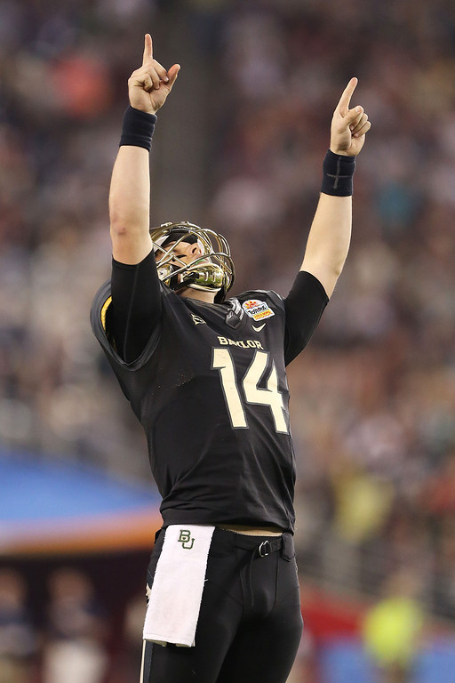 . GLENDALE, AZ - JANUARY 01:  Bryce Petty #14 of the Baylor Bears celebrates in the second quarter against the UCF Knights during the Tostitos Fiesta Bowl at University of Phoenix Stadium on January 1, 2014 in Glendale, Arizona.  (Photo by Christian Petersen/Getty Images)
