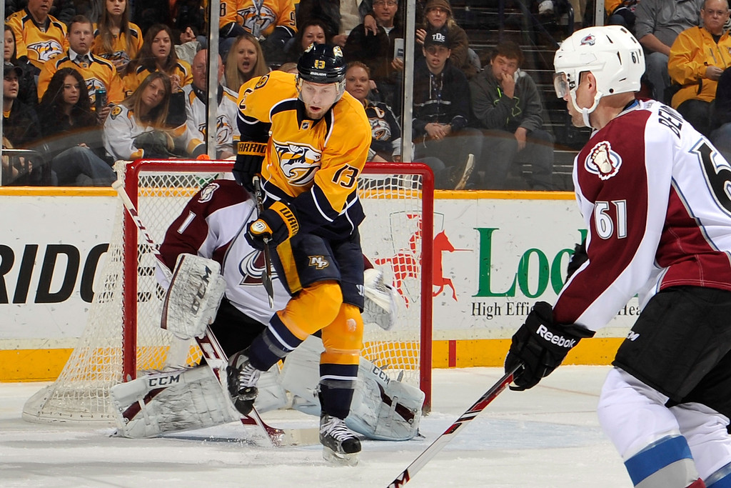 . NASHVILLE, TN - JANUARY 18:  Nick Spaling #13 of the Nashville Predators tries to deflect a shot onto goalie Semyon Varlamov #1 of the Colorado Avalanche at Bridgestone Arena on January 18, 2014 in Nashville, Tennessee.  (Photo by Frederick Breedon/Getty Images)