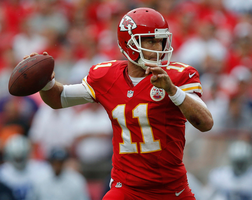 . Kansas City Chiefs quarterback Alex Smith (11) throws a pass during the first half of an NFL football game against the Dallas Cowboys at Arrowhead Stadium in Kansas City, Mo., Sunday, Sept. 15, 2013. (AP Photo/Ed Zurga)
