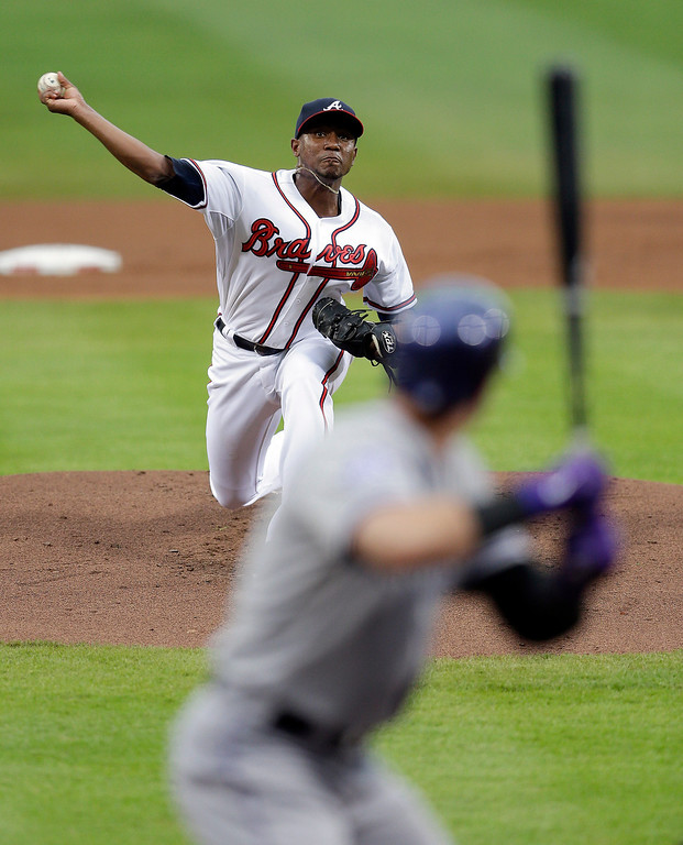 . Atlanta Braves starting pitcher Julio Teheran (49) delivers to a Colorado Rockies batter in the first inning of a baseball game in Atlanta, Thursday, Aug. 1, 2013. (AP Photo/John Bazemore)