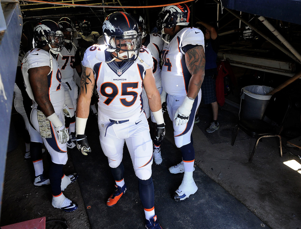 . Denver Broncos defensive end Derek Wolfe (95) gets ready to head out for pre game during their game against the San Diego Chargers at Qualcomm Stadium. (Photo by John Leyba/The Denver Post)