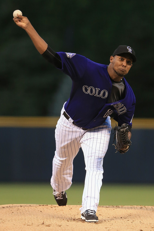 . Starting pitcher Juan Nicasio #12 of the Colorado Rockies delivers against the St. Louis Cardinals at Coors Field on September 17, 2013 in Denver, Colorado.  (Photo by Doug Pensinger/Getty Images)