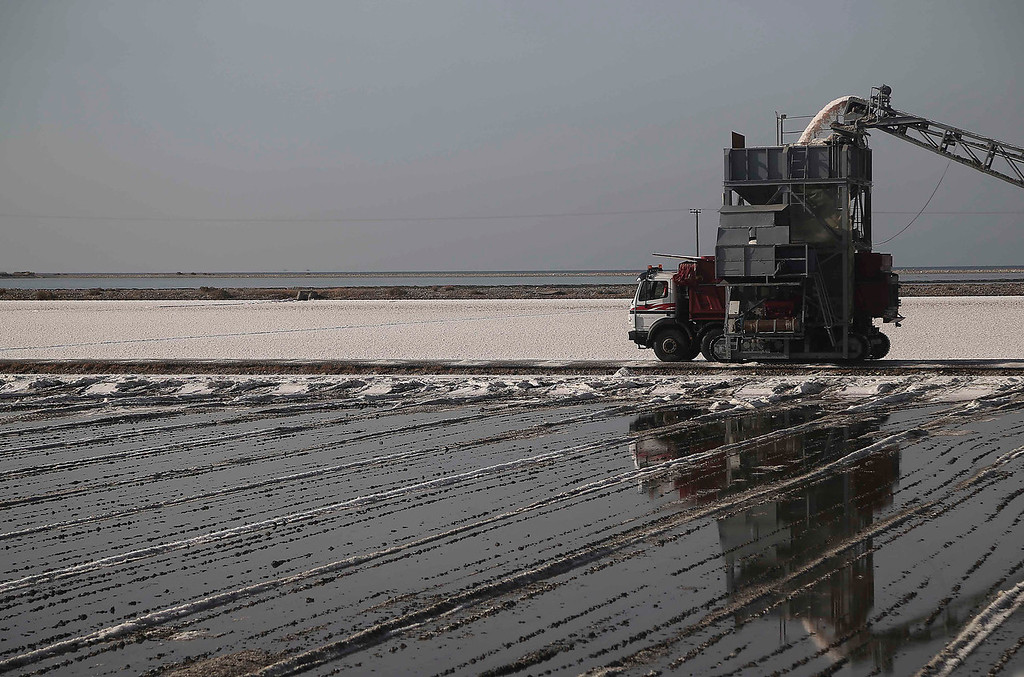 . Salt is loaded onto a truck at a production site in Messolongi, western Greece. Salt lakes at Messolongi are used for production by solar evaporation. The facilities are the largest saltworks in Greece, and are located at a protected wetland complex of estuaries and lagoons. (AP Photo/Dimitri Messinis)