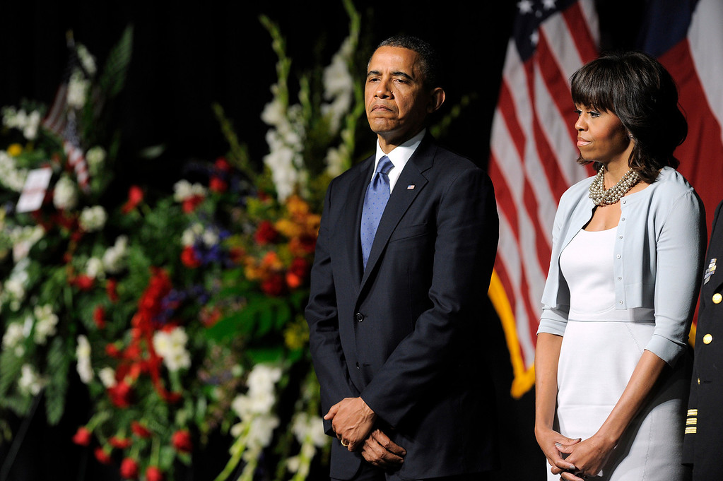 . US President Barack Obama and First Lady Michelle Obama attend a memorial service at Baylor University in Waco, Texas, on April 25, 2013 for the firefighters who were killed in a huge blast at a Texas fertilizer plant last week.  AFP PHOTO/Jewel SAMAD/AFP/Getty Images
