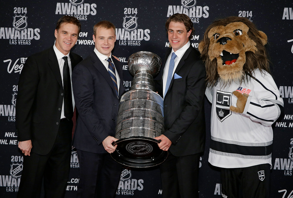 . From left, Luc Robitaille, Dustin Brown, and Anze Kopitar and the mascot of the Los Angeles Kings pose with the Stanley Cup on the red carpet before the NHL Awards on Tuesday, June 24, 2014, in Las Vegas. (AP Photo/John Locher)