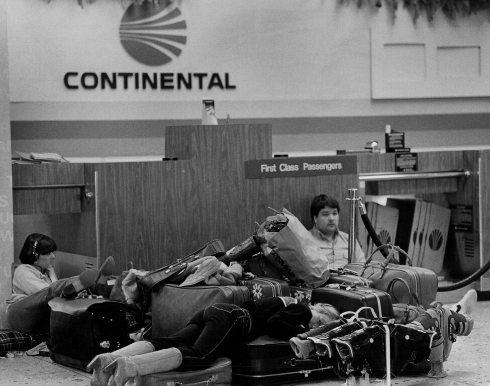 . People trying to make the best of it while stranded at the airport during the Blizzard Of \'82. Denver Post Library Archive