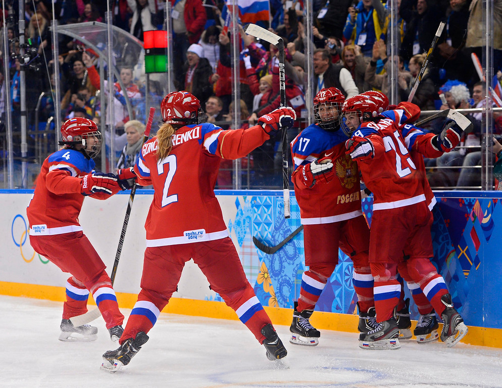 . Iya Gavrilova (R) of Russia celebrates with teammates after scoring a goal against Germany in the third period during their match in the Ice Hockey tournament at the Sochi 2014 Olympic Games in Sochi, Russia, 09 February 2014.  EPA/LARRY W. SMITH
