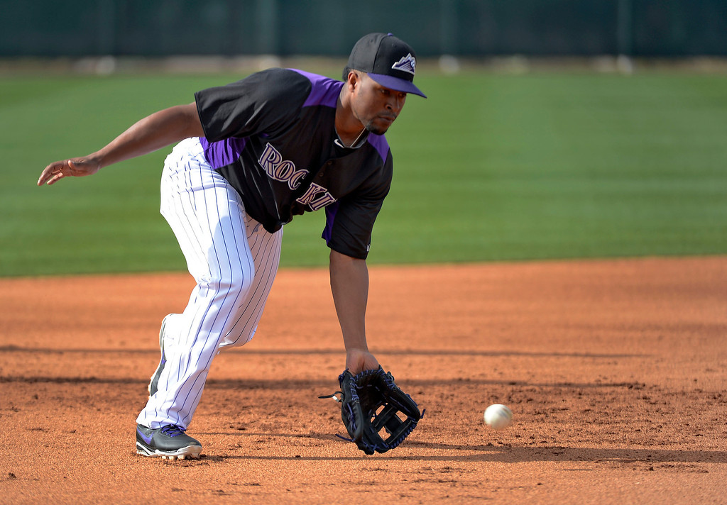 . SCOTTSDALE, AZ. - FEBRUARY 19: Chris Nelson (4) of the Colorado Rockies scoops up a grounder during workouts at Spring Training February 19, 2013 in Scottsdale. (Photo By John Leyba/The Denver Post)