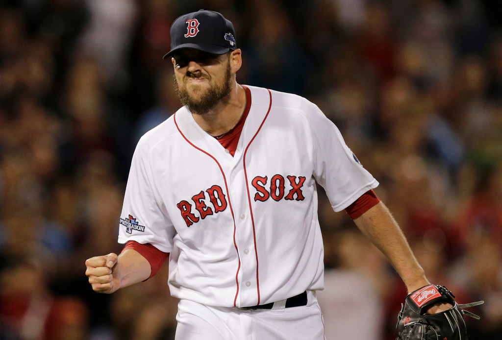 . Boston Red Sox starting pitcher John Lackey clenches his fist after striking out Tampa Bay Rays\' Ben Zobrist to end the top of the fifth inning of Game 2 of baseball\'s American League division series, Saturday, Oct. 5, 2013, in Boston. (AP Photo/Charles Krupa)