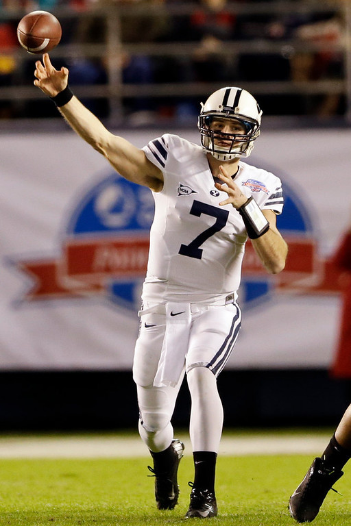 . BYU quarterback James Lark throws a pass against San Diego State during the first half of the Poinsettia Bowl NCAA college football game, Thursday, Dec. 20, 2012, in San Diego. (AP Photo/Lenny Ignelzi)