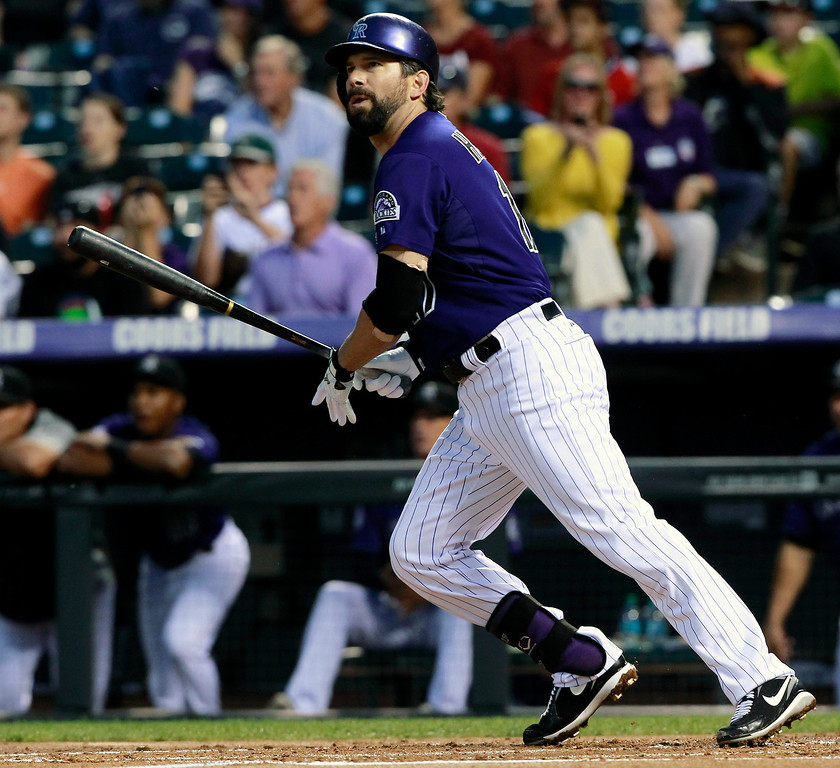 . Colorado Rockies\' Todd Helton follows the flight of his fly out against the St. Louis Cardinals to end the first inning of a baseball game in Denver on Tuesday, Sept. 17, 2013. (AP Photo/David Zalubowski)