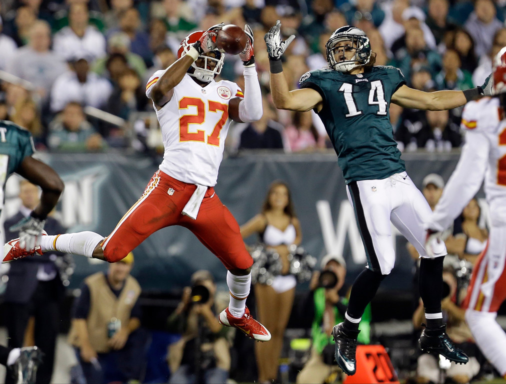 . Kansas City Chiefs\' Sean Smith (27) intercepts a pass intended for Philadelphia Eagles\' Riley Cooper (14) during the first half of an NFL football game, Thursday, Sept. 19, 2013, in Philadelphia. (AP Photo/Julio Cortez)