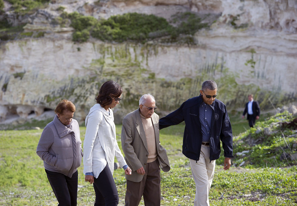 """. US President Barack Obama (R), and First Lady Michelle Obama (2L) listen to former prisoner Ahmed Kathrada with Michelle Obama\'s mother Marian Robinson (L) as they tour the limestone quarry where prisoners worked on Robben Island off the coast of Cape Town, South Africa on June 30, 2013. President Barack Obama was \""""deeply humbled\"""" by a visit to the cell where Nelson Mandela spent years as a prisoner, in a solemn homage Sunday to the critically ill hero he was unable to see in Pretoria.  SAUL LOEB/AFP/Getty Images"""