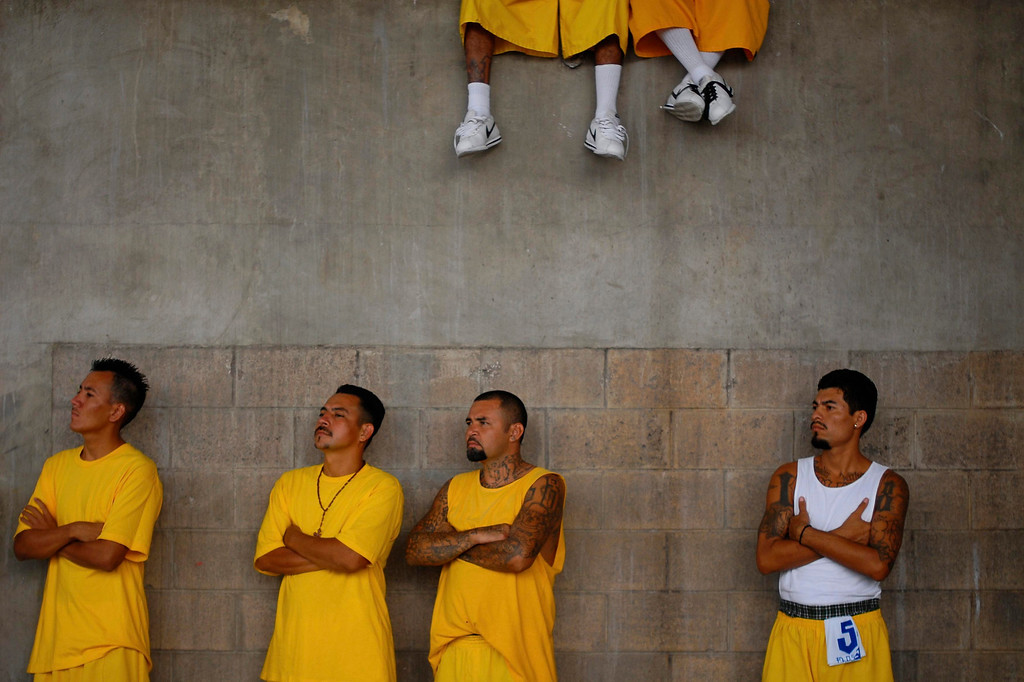 . Members of the 18th Street gang attend a mass at the prison of Izalco, about 65 km (40 miles) from San Salvador April 13, 2012. Rival gangs operating in El Salvador have called for a truce as the Central American country confronts a plague of violent crime, according to a statement issued by the gangs. The document, signed by representatives of the country\'s two most powerful gangs, Mara Salvatrucha and the 18th Street gang (Mara 18), was delivered to the local media and has been endorsed by the Roman Catholic Church in El Salvador, according to local church leaders. REUTERS/Ulises Rodriguez