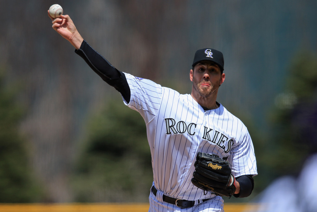 . Starting pitcher Jon Garland #27 of the Colorado Rockies delivers against the New York Mets at Coors Field on April 18, 2013 in Denver, Colorado.  (Photo by Doug Pensinger/Getty Images)