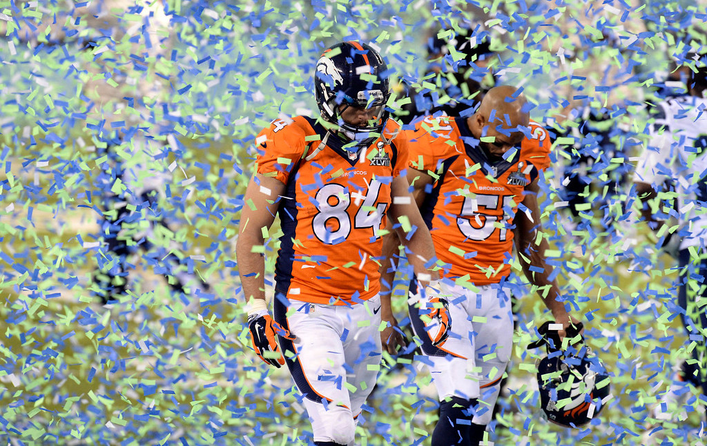 . Denver Broncos tight end Jacob Tamme (84) and Denver Broncos middle linebacker Paris Lenon (51) walk through the Seahawks confetti after being defeated by the Seahawks 43 to 8.  The Denver Broncos vs the Seattle Seahawks in Super Bowl XLVIII at MetLife Stadium in East Rutherford, New Jersey Sunday, February 2, 2014. (Photo by Hyoung Chang//The Denver Post)